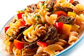 istock Pasta with tomato sauce and grilled beef 1046559400