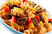 istock Pasta with tomato sauce and grilled beef 1046559660