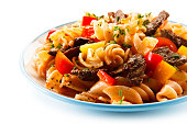 istock Pasta with tomato sauce and grilled beef 1046559816