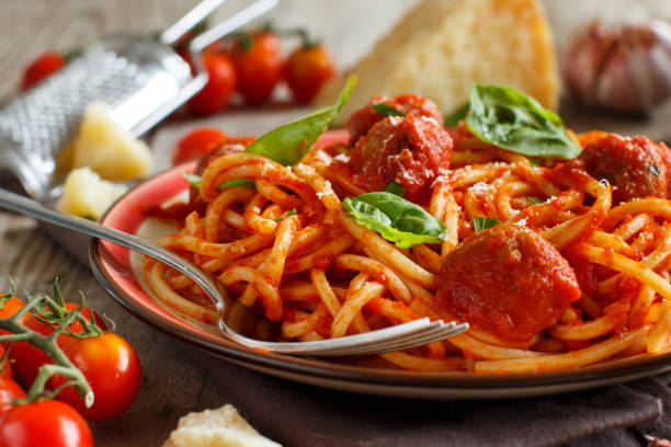 Pasta with tomato sauce and meatballs Pasta with tomato sauce and meatballs on a dark background spaghetti stock pictures, royalty-free photos & images