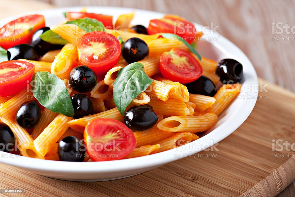 Pasta with tomato sauce and olives royalty-free stock photo