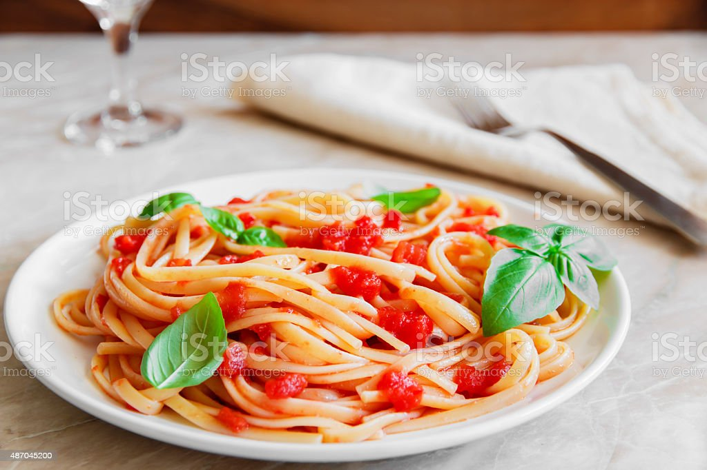 Pasta with tomato sauce on a plate stock photo