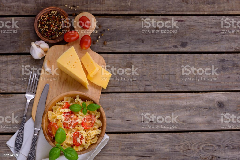 Pasta with tomatoes and sauce with basil stock photo