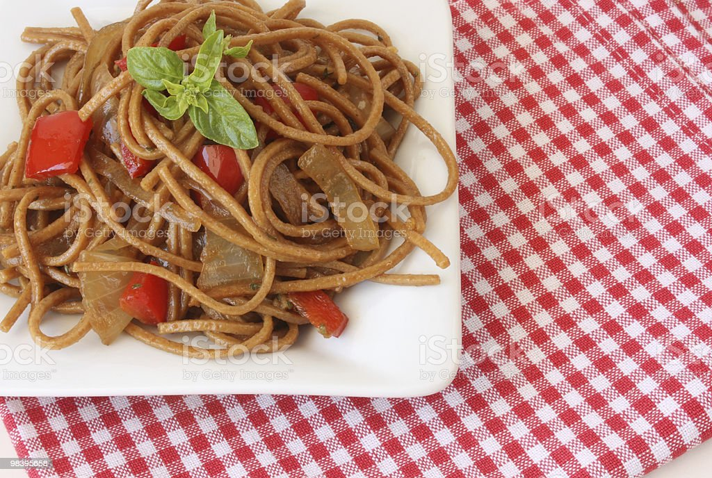 Pasta with vegetables and basil royalty-free stock photo