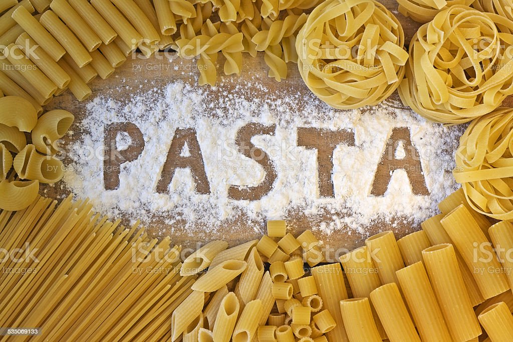 Pasta word with wood background stock photo