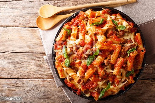 istock Pasta ziti with bolognese sauce and cheese close-up. horizontal top view, rustic style 1060547602