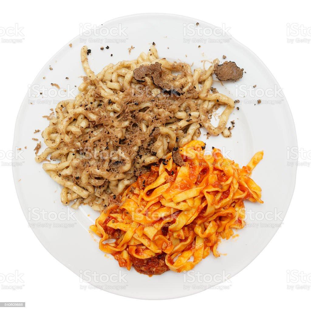 Pastas with black truffle and tomato sauce stock photo
