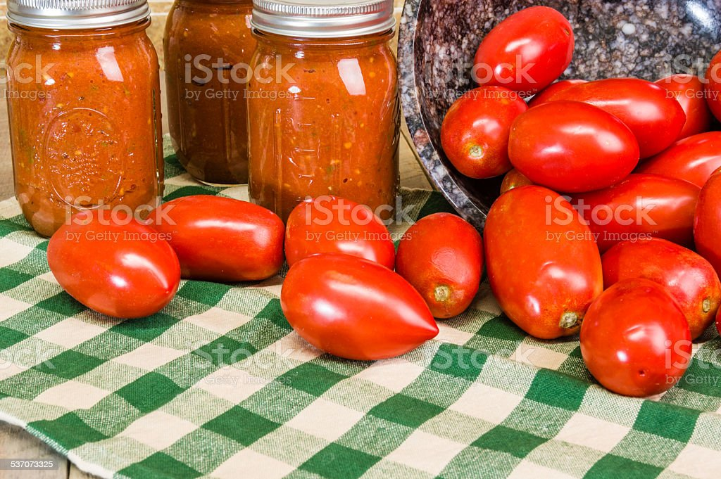 Paste tomatoes and jars of sauce stock photo