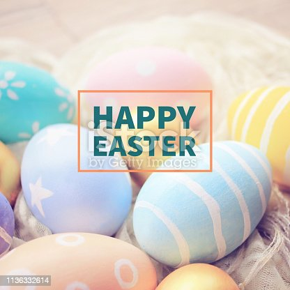 istock Pastel and colorful easter eggs with happy easter word 1136332614