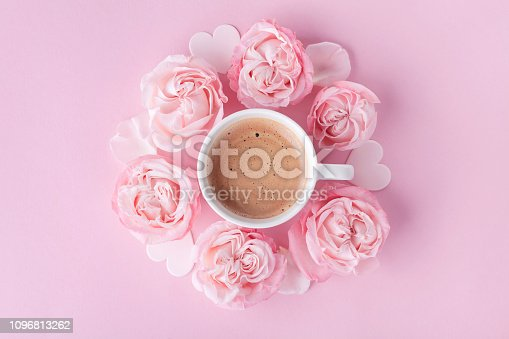 istock Pastel background with morning cup of coffee and beautiful rose flowers. Cozy breakfast for Womens day. 1096813262