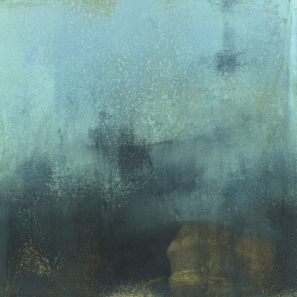 A hand painted mottled background. The prominent colors are shades of blue and dark grey and gold. There is a texture throughout the painting.