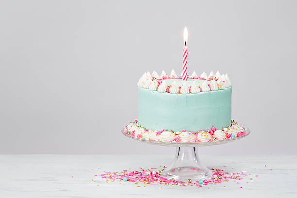 Pastel Blue Birthday Cake over White Background. stock photo