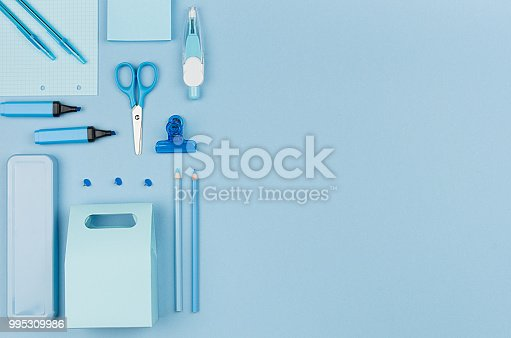 818533812 istock photo Pastel blue office stationery collection on soft elegance blue background with copy space, top view. 995309986