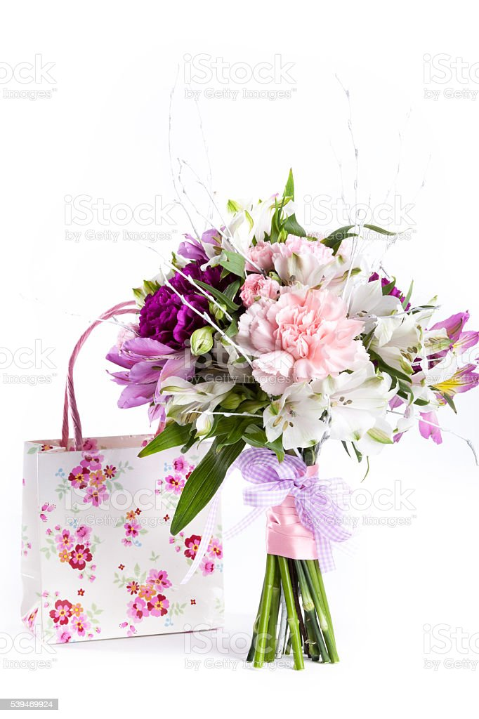Pastel bouquet from pink and purple gillyflowers on white stock photo