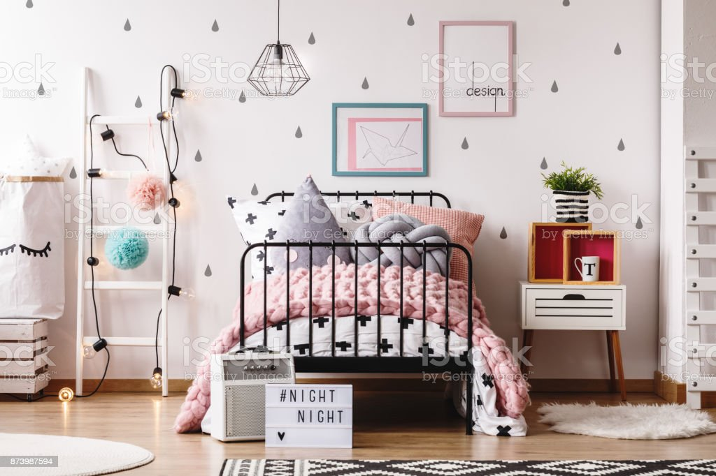 Pastel child's bedroom with rugs royalty-free stock photo