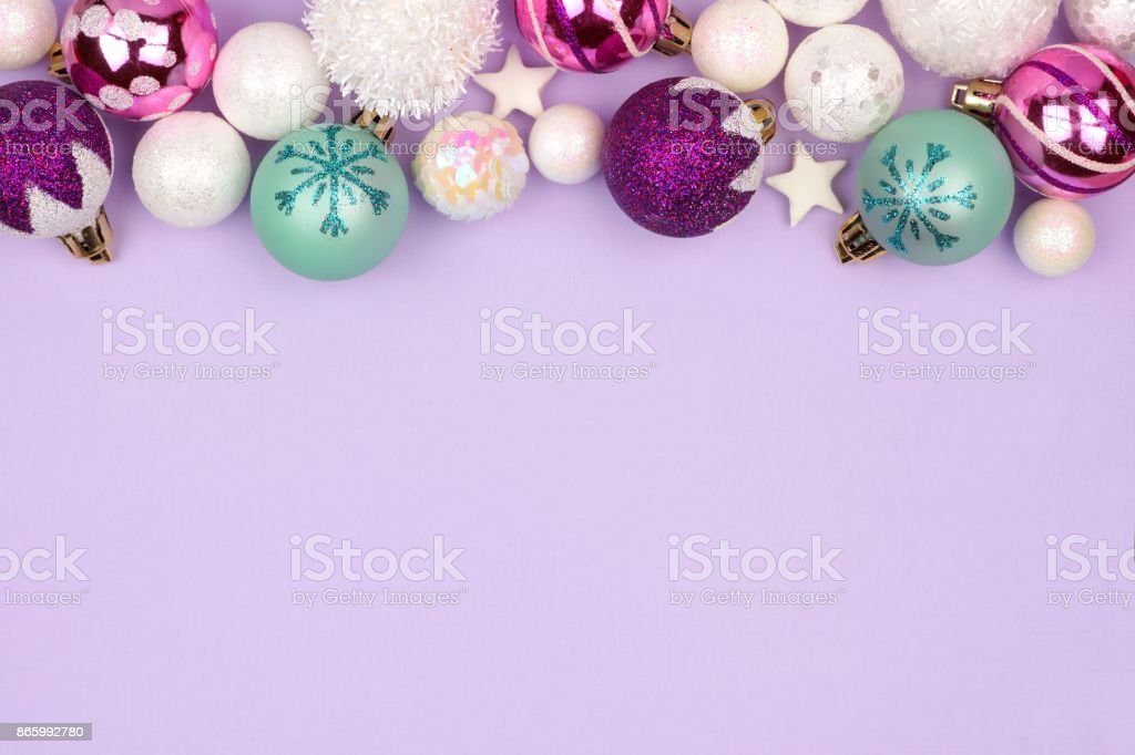 Christmas Top Border.Pastel Christmas Bauble Top Border Over Purple Stock Photo