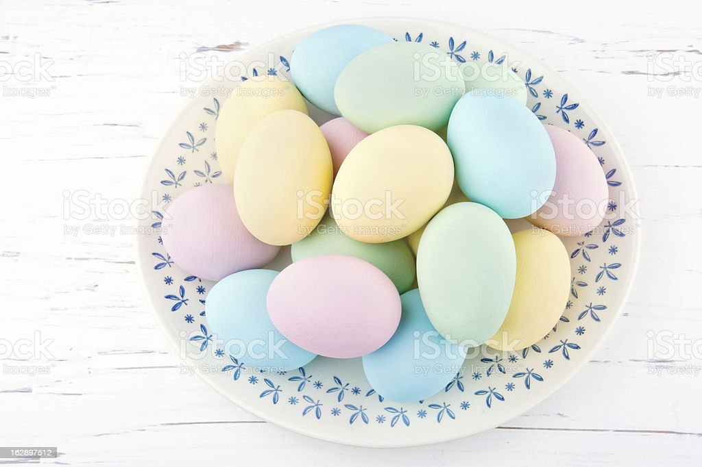 Pastel color easter eggs on old plate royalty-free stock photo