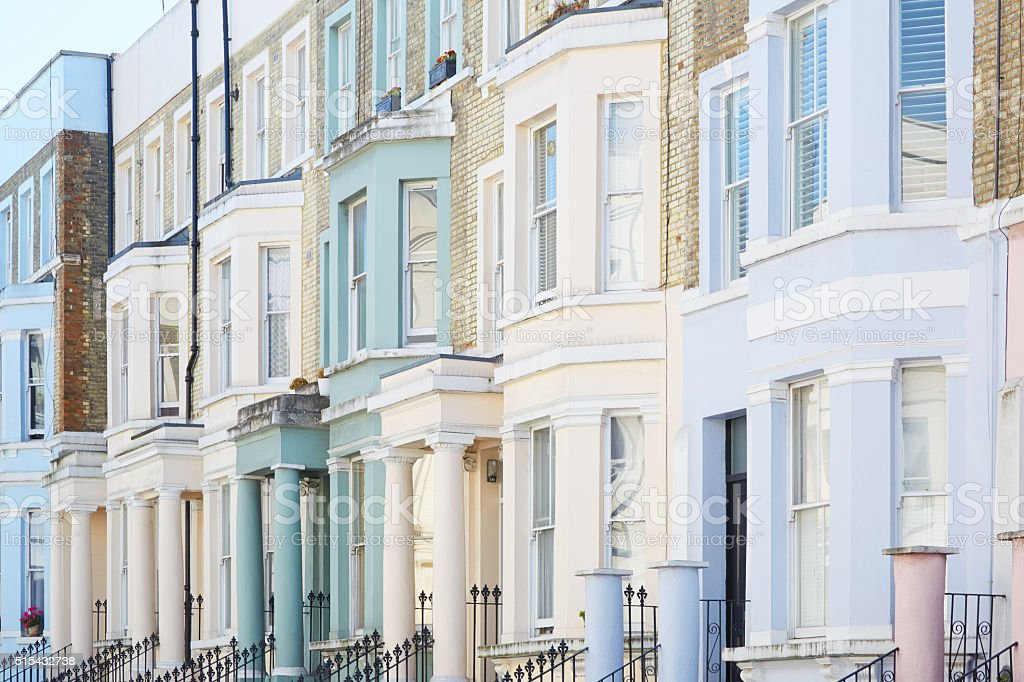 Pastel color houses facades in London stock photo