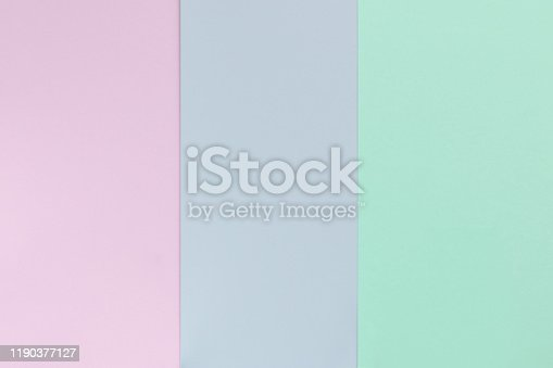 Pastel color paper background. Geometric flat composition. Empty space on monochrome cardboard
