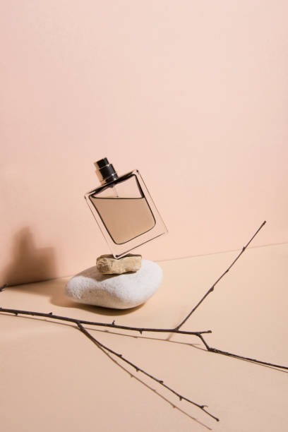 pastel color perfume falling from the a stone . abstract still life. makeup collection 5. - profumi foto e immagini stock