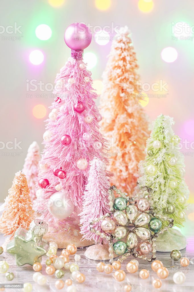 Pastel colored christmas trees stock photo