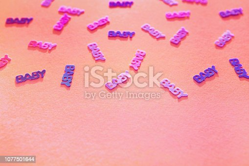 875685464istockphoto Pastel coloгred confetti baby on pink background 1077501644