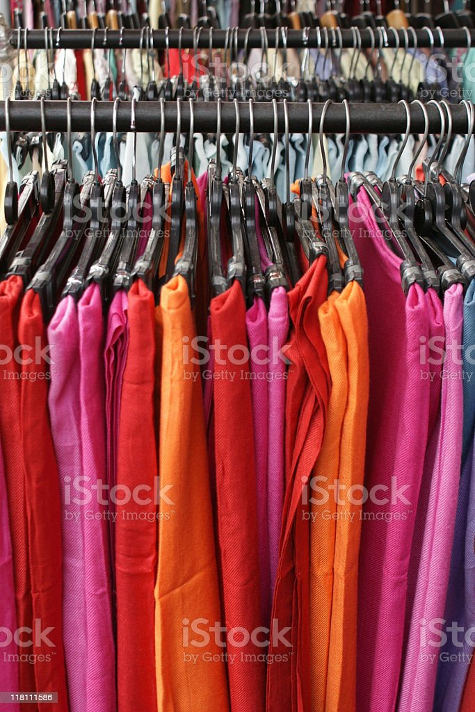 Pastel colored scarves on hangers royalty-free stock photo