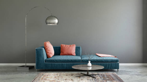 Pastel colored sofa with blank wall template stock photo