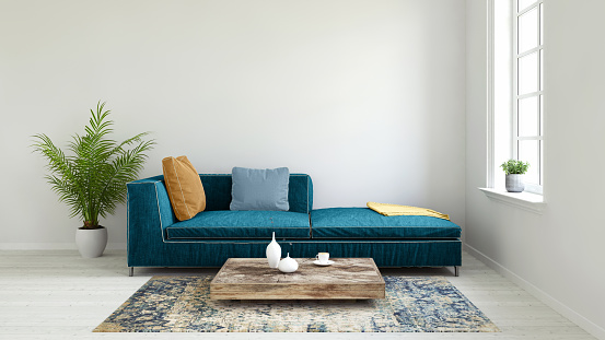Interior scene with pastel colored sofa with colorful pillows, blank wall for copy space. Modern interior template for copy space. Floor lamp, carpet and coffee table with  vase.