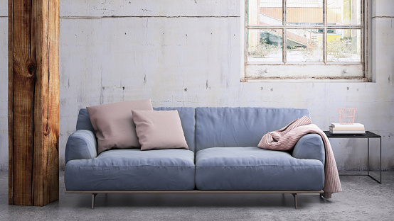 Interior scene with pastel colored sofa with pillows, blank wall for copy space. Modern interior template for copy space.