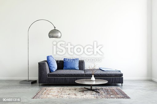 istock Pastel colored sofa with blank wall template 904651316