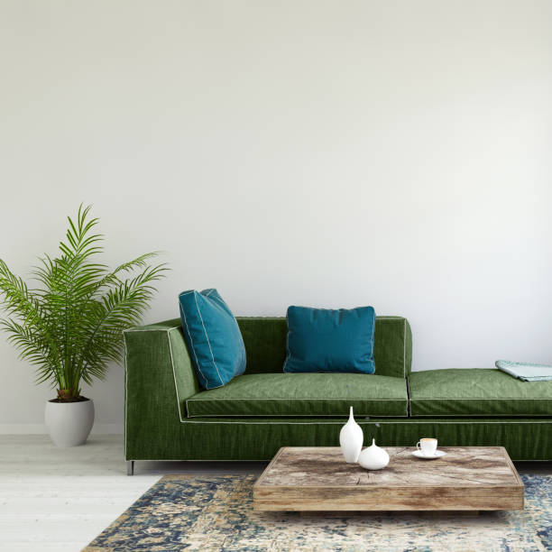 pastell farbigen sofa mit leeren wandschablone - tischsofa stock-fotos und bilder
