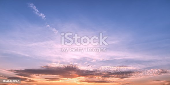 917116520 istock photo Pastel colored sunset sky panoramic view 1044405822