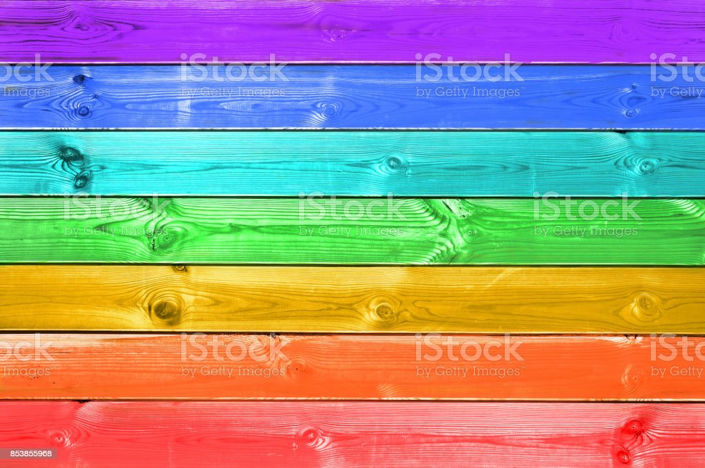 Pastel colorful rainbow painted wood planks background, gay flag...