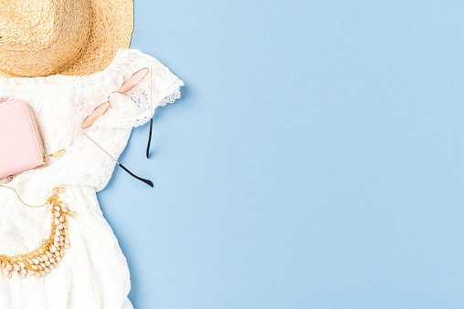 640200626 istock photo Pastel coloured fashion background with female outfit 1257805124