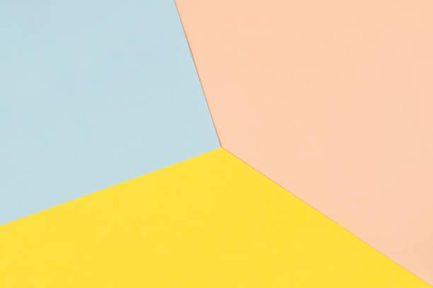 pastell farbigen papierhintergrund - farbiges papier stock-fotos und bilder