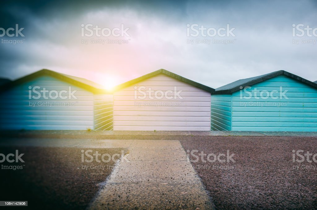 Pastel Coloured Wooden Beach Huts stock photo