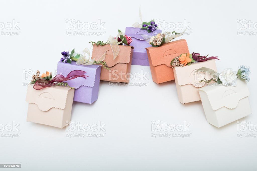 Pastel colours   carton bithday gift boxes with ribbon and flowers with text space stock photo