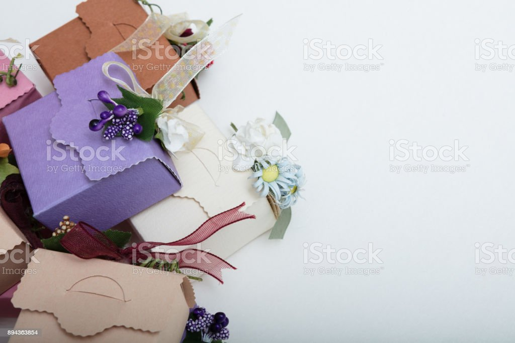 Pastel colours carton wedding gift boxes with ribbon and flowers