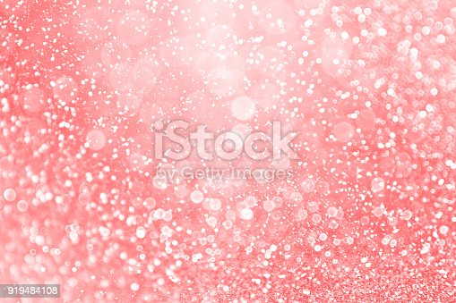 istock Pastel Corel Pink and Peach Glitter Background Backdrop 919484108