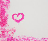 Pastel crayon sketch of pink heart within  pink border