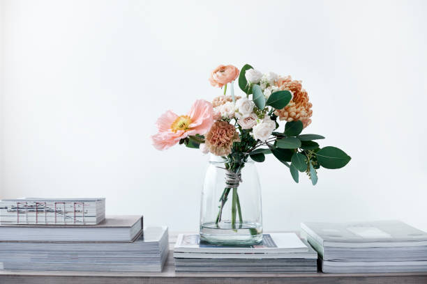 pastel cut flowers in a glass vase bouquet of poppies ranunculus eucalyptus chrysanthemums roses carnations arrangement stock pictures, royalty-free photos & images