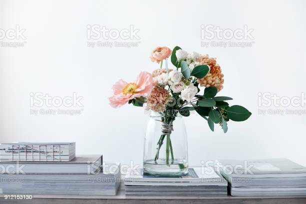 bouquet of poppies ranunculus eucalyptus chrysanthemums roses carnations
