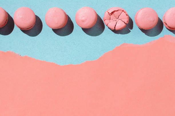 Pastel flatlay of pink vegan macaroons on pastel stock photo