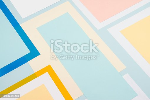 Sheets of pastel colored papers, and translucent papers for abstract geometric background