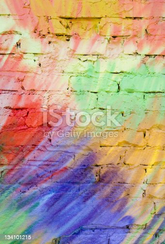 All the colors of the rainbow in this detail of a wall covered in graffiti. Use as background, texture or picture in its own right.