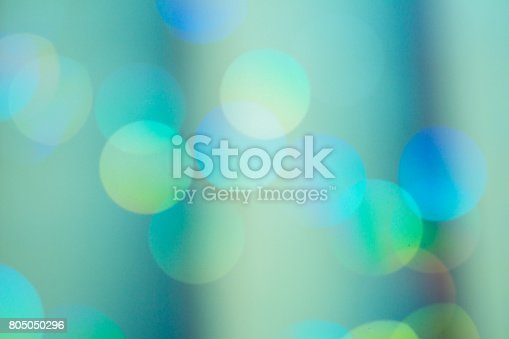 istock Pastel Green Color Defocused Christmas Light Bokeh 805050296