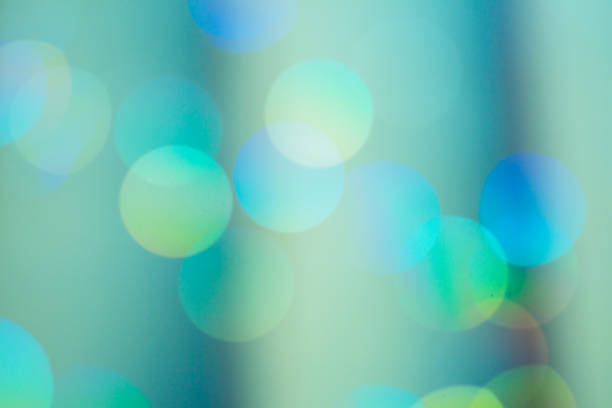 Pastel Green Color Defocused Christmas Light Bokeh stock photo