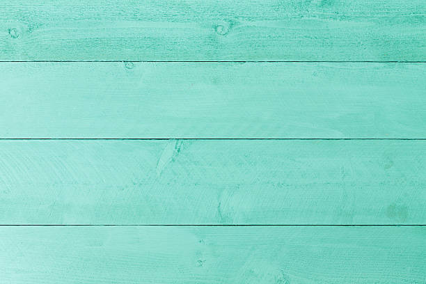 pastel green stained wood background texture - bosco foto e immagini stock