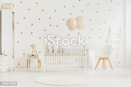 istock Pastel lanterns above baby's bed 859575554